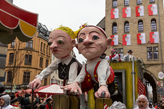 Satirical float with the paper mache characters of the traditional Hänneschen-Theater in Cologne. Hänneschen and Bärbelchen are here a symbol of tenants who have to leave their homes after many years due to gentrification