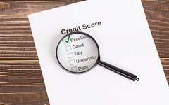 Excellent Credit Score result with magnifying glass