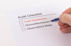 Man filling out Audit Checklist