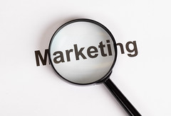 Marketing text under magnifying glass