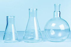 Empty flasks on a light blue background. Laboratory glassware
