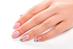 Female hand with pink manicure