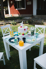 A Easter table set for an open air lunch in a garden.