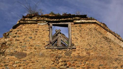 Abandoned derelict fieldstone farmhouse - Sauveterre-de-Béarn, Pyrénées-Atlantiques, France.