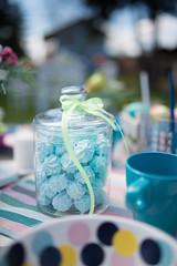 Blue cookie in jar outdoors.
