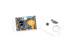 Disassembled action camera on a white background