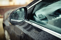 Water drops on rearview mirror of a car.