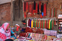 Selling local handicrafts against an earthquake ravaged building
