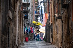 Street life in the narrow streets of Palermo on the island of Sicily, Italy.