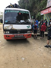 A Tata 709 bus makes a pit stop with a trekking group