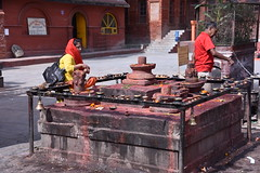 A platform with the Hindu phallic Lingam in the centre also serves as a stand for oil lamps