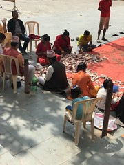Counting the day's collections in the Budhanilkantha temple
