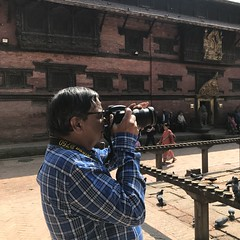 My guide took this candid of me taking pictures in the Lalitpur/ Patan Durbar Square