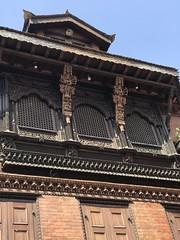 Beautiful woodwork on the upper floor windows of one of the shrines in the Durbar Square in Lalitpur/ Patan