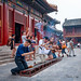 Worshippers outside The Hall of Everlasting Protection at the Yonghe Temple