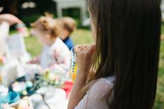 Young girl drinking orange juice closeup.