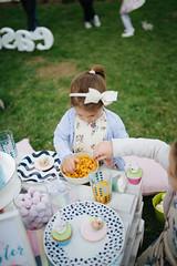 Little girls eating lunch in the garden.
