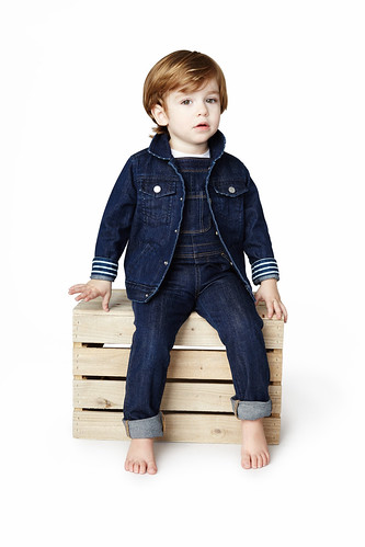 Young-boy-toddler-child-in-denim-outfit-sitting-on-box-studio-photo