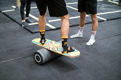 Man using a balance board at the gym