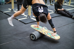 Man standing on his hands on a balance board