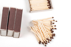 Matchbooks and scattered matches on a white background