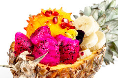 Half of a pineapple stuffed with different fruits