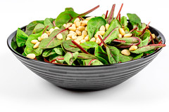 Fresh salad with spinach and pine nuts. Dietary food