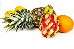 Ripe fresh exotic fruit on a white background