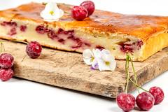 Homemade cherry pie on a wooden kitchen Board
