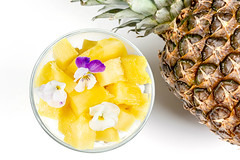 Cottage cheese with fresh pineapple, Chia seeds and edible flowers
