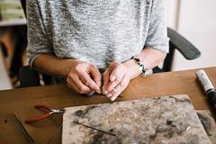 Jewelry maker. Arms closeup.