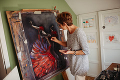 Artist painting at home. Colorful ballerina.