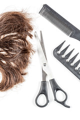 Brown hair with scissors and combs, top view
