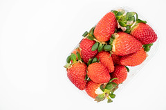 Fresh Raw Strawberries above white background with copy space