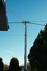 Electric pole or utility pole supporting wires for various public utilities such as cable internet with fresh blue sky