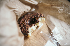 Half chocolate donut close up