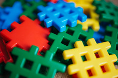Plastic colored pieces toy closeup.