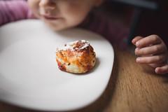 Little girl having breakfast.