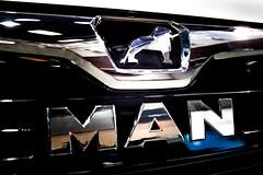 MAN company logo on a van close-up