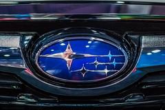 Subaru company logo on a car close-up