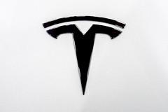 Tesla logo on a car close-up