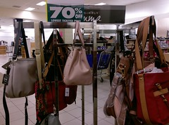 Posing purses (upstaged by a suspiciously large selection of shoes in the blurry background)!
