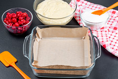 Empty baking tray and ingredients for making berry pie