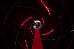 Black tunnel with red light lights