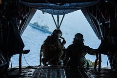 Marines look at USS Bunker Hill (CG 52) from a CH-53E Super Stallion helicopter.