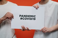 People holding white paper with pandemic covid19  - Credit to https://homegets.com/