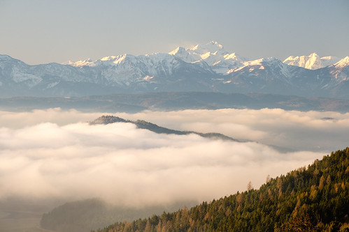 Early morning view of Kamnik alps and a cloud inversion