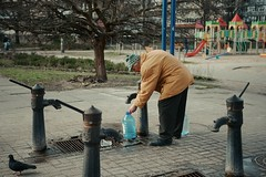У бювета / At the pump