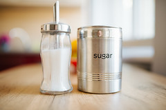 Sugar in glass jar and conserve at home.