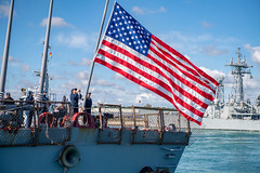 Sailors aboard USS Donald Cook (DDG 75) shift colors as the ship departs Naval Station Rota, Spain.